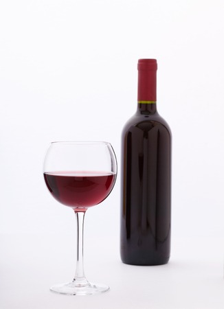 pouring wine: Glass and bottle of red wine. Flat mock up for design unusually on white background. Stock Photo