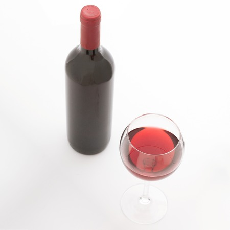pouring wine: Glass and bottle of red wine. Flat mock up for design. Top view unusually on white background.