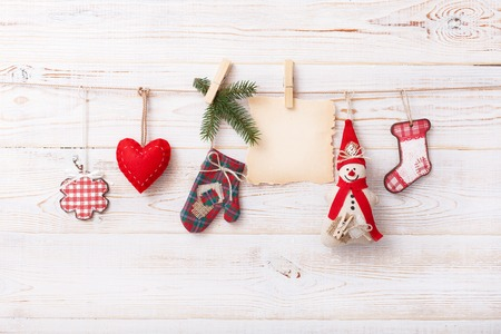 turns of the year: Christmas composition of toys handmade Christmas tree on a wooden background Stock Photo