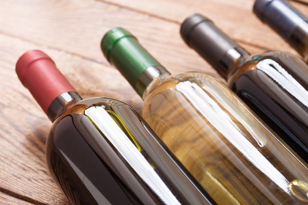 intoxicant: Wine bottles on wooden background. Flat mock up for design. Stock Photo