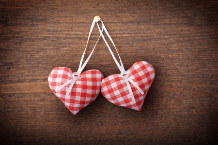 full willow: Two hearts and wooden background. Valentine background.