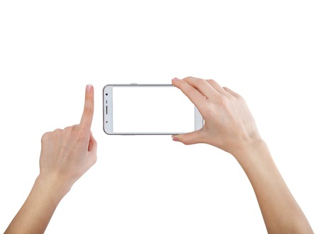 horizontal: Female hands taking photo with smart phone of blank white touch screen, front view, isolated on white.