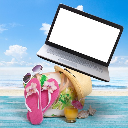 freelancing: Summer Holidays in Beach Seashore. Workplace freelancing. Fashion accessories summer flip flops, hat, sunglasses on bright turquoise board near the beach