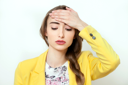malady: Beautiful Woman having headache on white background