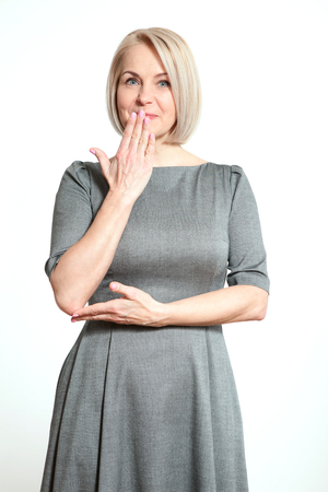 hearsay: Portrait  beautiful woman with finger on lips, or secret gesture hand sign  isolated on white background