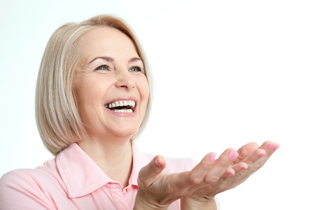 Friendly smiling middle aged woman isolated on white background Reklamní fotografie - 57872753