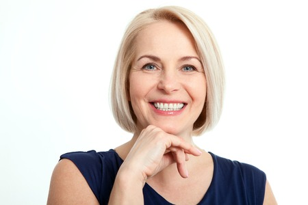 middleaged: Friendly smiling middle-aged woman isolated on white background Stock Photo