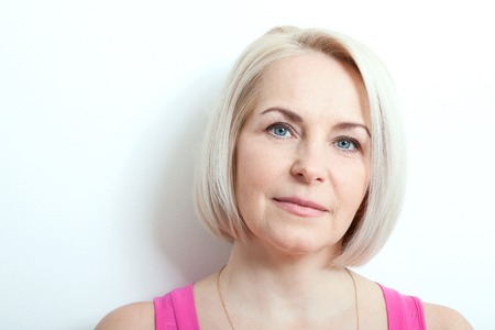 aged: Magnificent portrait of beautiful middle aged woman with perfect skin closeup. Portrait of elegant middle aged woman