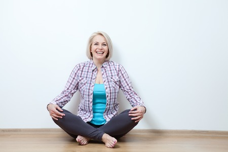 attractive middle aged woman relaxing at home Stock Photo - 63091992
