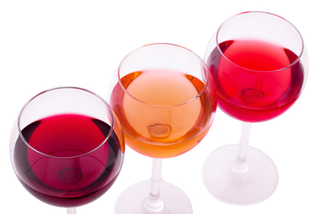 Red, white and rose wine glasses up on white isolated. Top view..