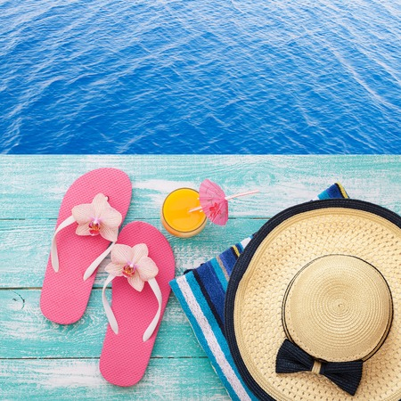 bikini top: Summer fun time and accessories on blue wooden background. Mock up Stock Photo