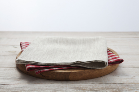 Napkin. Stack of colorful dish towels on white wooden table background top view