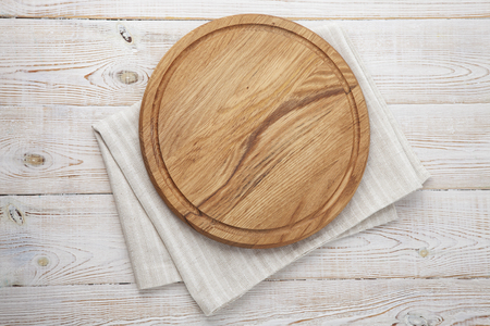Pizza board, canvas napkin with lace on wooden table. Top view mock up Stockfoto