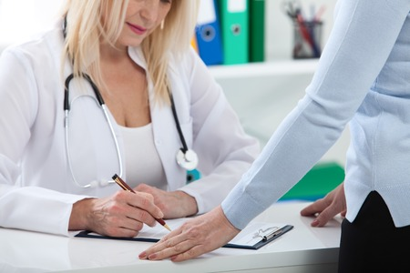 Healthcare and medical concept - doctor with patient in hospital Stock Photo