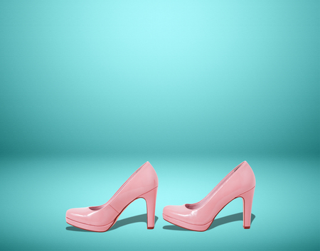Fashion female pink shoes with heels. Womens footwear casual design isolated on blue background with free space for text.
