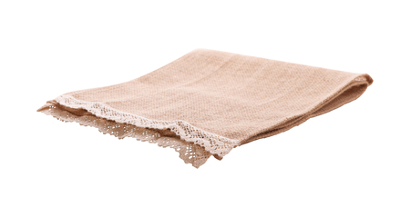 Empty canvas napkin with lace, tablecloth isolated on white background. Can used for display or montage your products. Selective fokus Stock Photo