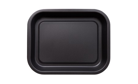 Empty baking tray for pizza close up isolated. Top view horizontally. Stock Photo