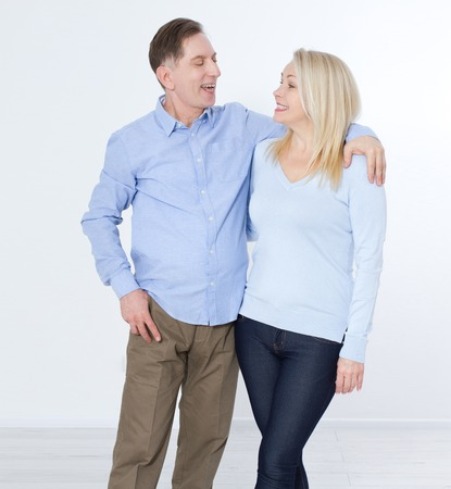 Full length portrait of happy mature couple standing with hands Stock Photo
