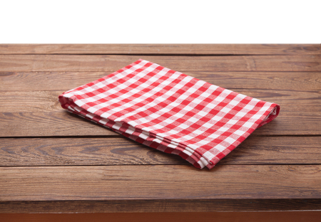 Kitchen towel on empty wooden table. Napkin close up top view mock up for design.