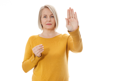 Excited middle aged woman showing the sign of stop, neglect negation and reluctance Standard-Bild - 125305995