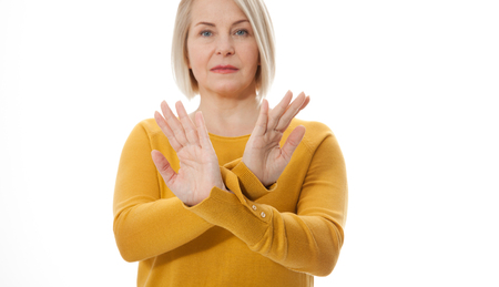 Excited middle aged woman showing the sign of stop, neglect negation and reluctance Standard-Bild - 125306002