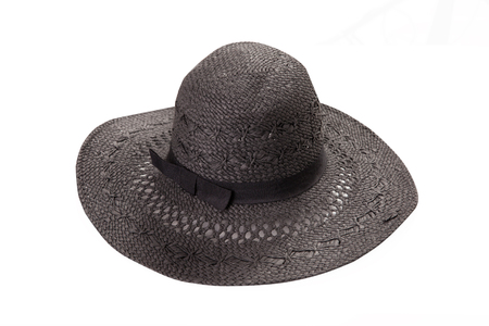 Pretty straw hat with ribbon and bow on white Standard-Bild - 125306018