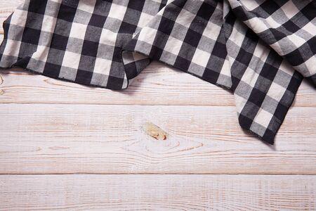 Napkin on white wooden table. Standard-Bild - 129144136