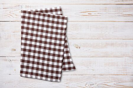 Napkin. Kitchen towel or table cloth on white wooden scene. Mock up for design. Top view mockup. Standard-Bild - 139671448