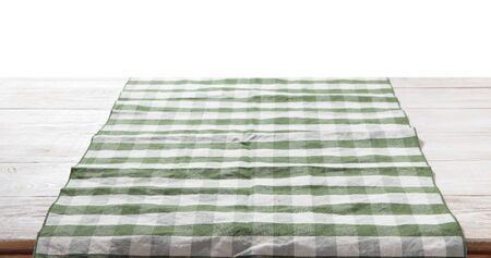 Kitchen towel on empty wooden table on white background. Napkin close up top view mock up for design. . Standard-Bild - 139676695
