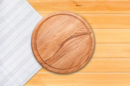 Table cloth and pizza board on vintage wooden table. Top view mockup