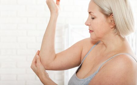 Woman with pain in arm, elbow. Pain in the human body, health care concept.
