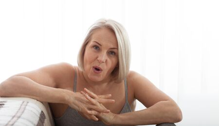 Angry stressed senior middle aged woman annoyed with problems, mad worad mature lady frustrated about bad news at home Stock Photo