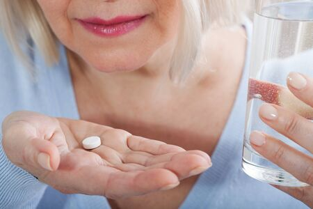 Pills on female hands , Suicide concept