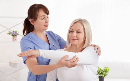 Doctor and patient in rehabilitation clinic. Closeup