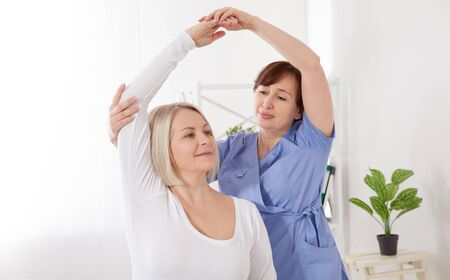 Physiotherapy, sport injury rehabilitation treatment. Woman having chiropractic back adjustment. Osteopathy, Alternative medicine, pain relief concept.