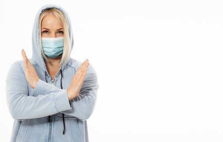 Woman wearing face mask. Concept coronavirus, respiratory virus. Sign with hands stop