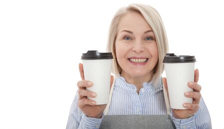 Part-time job coffee break relax leisure pause concept. Friendly pleasant woman barista giving two big latte isolated on gray background copy-space