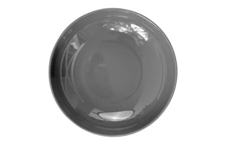Empty black plate isolated on white background Foto de archivo