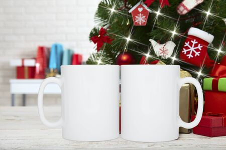 Winter Mug mockup, blank cup with Christmas background. New yars decoration on festive background. Holiday concept