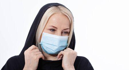 Concept coronavirus, covid-19 respiratory virus. Woman wearing face mask.