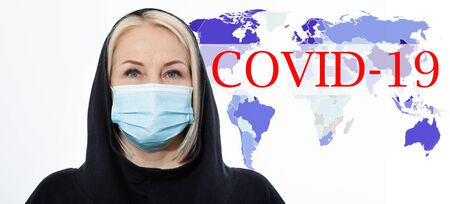 Face of a woman wearing a mask. Concept coronavirus, respiratory virus and Air pollution. Text Covid-19