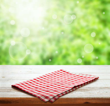 Napkin. Tablecloth tartan, checkered, dish towels on wooden table perspective. Foto de archivo