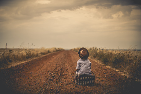 road ahead: child watching the road ahead