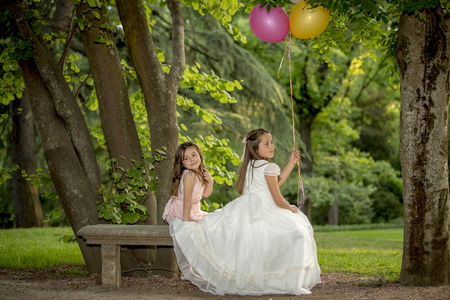Girls of communion in a park in Madrid, Spain Banco de Imagens