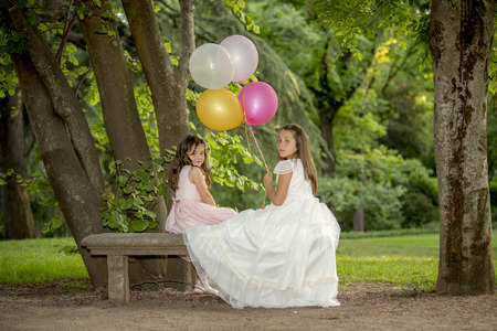 Girls of communion in a park in Madrid, Spain Stock Photo