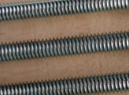 Three parallel screws on white background.