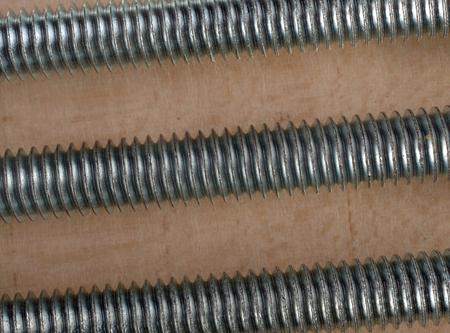 hobbyist: Three parallel screws on white background.