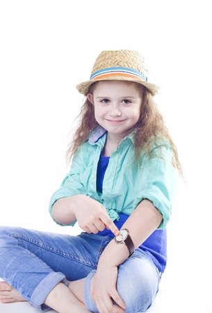 Young beautiful girl  looking at her watch isolated studio shot photo