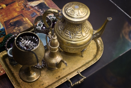 antique bronze tea pot on a tray Stock Photo