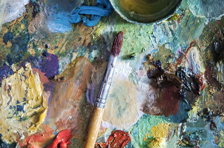 overhead shot of a dirty painter palette and brush photo